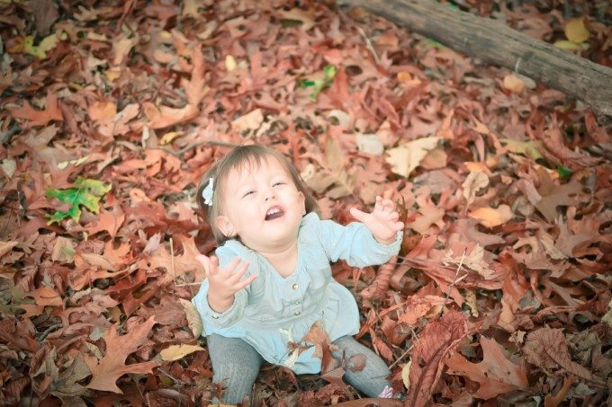 baby in leaves